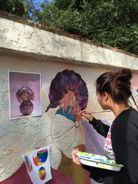 Student Muralists Go 'Through the Looking Glass'