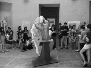 students studying a sculpture